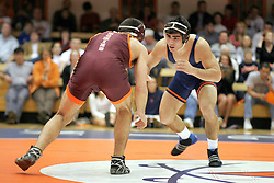 Mike Sewell takes on Virginia Tech's Dave Kiley.  Sewell lost the match 3-1, but UVA prevailed against the Hokies 25-15.