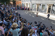 UNITED KINGDOM, London: 24 July 2019 The new British Prime Minister Boris Johnson walks up to address members of the media outside No.10 Downing Street after speaking with Her Majesty The Queen at Buckingham Palace and officially becoming British Prime Minister.<br /> Rick Findler / Story Picture Agency