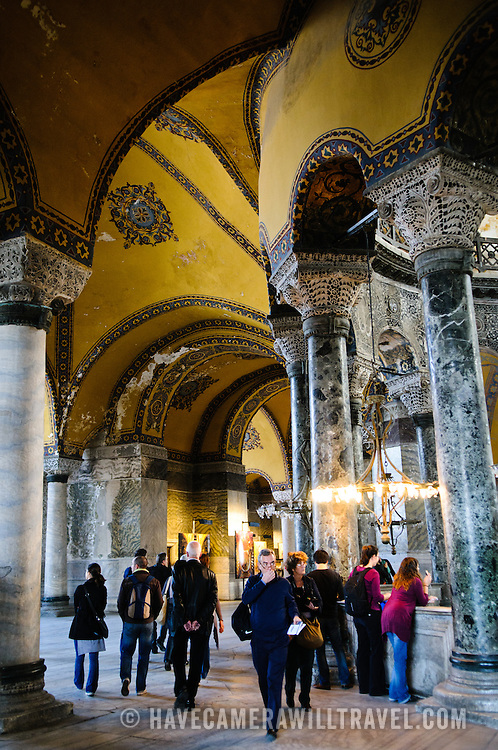 Tourists on the second floor of Hagia Sophia. Originally built as a Christian cathedral, then converted to a Muslim mosque in the 15th century, and now a museum (since 1935), the Hagia Sophia is one of the oldest and grandest buildings in Istanbul. For a thousand years, it was the largest cathedral in the world and is regarded as the crowning achievement of Byzantine architecture.