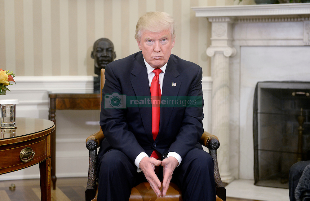 President-elect Donald Trump looks on in the Oval Office of the White House during a meeting with U.S. President Barack Obama in their first public step toward a transition of power November 10, 2016 in Washington, DC. Photo by Olivier Douliery/ ABACA
