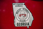 The logo on the door of a Georgia Department of Natural Resources truck on Ossabaw Island.