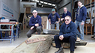 England, Emsworth, The Boat Project. 25  February  2011.  A team from the National Trust make a donation to The Boat Project.