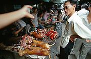 Hom Market. Dog meat vendor.