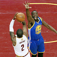 10 June 2016: Cleveland Cavaliers guard Kyrie Irving (2) takes a jump shot over Golden State Warriors forward Draymond Green (23) during the Golden State Warriors 108-97 victory over the Cleveland Cavaliers, during Game Four of the 2016 NBA Finals at the Quicken Loans Arena, Cleveland, Ohio, USA.