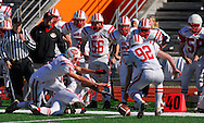 31 Oct. 2009 -- EAST ST. LOUIS, Ill. -- Players from Bradley-Bourbonnais High School jump on a fumble of the opening kickoff during the start of their game against East St. Louis in an opening-round IHSA playoff game Saturday, Oct. 31, 2009 in East St. Louis, Ill. Photo © copyright 2009 by Sid Hastings.