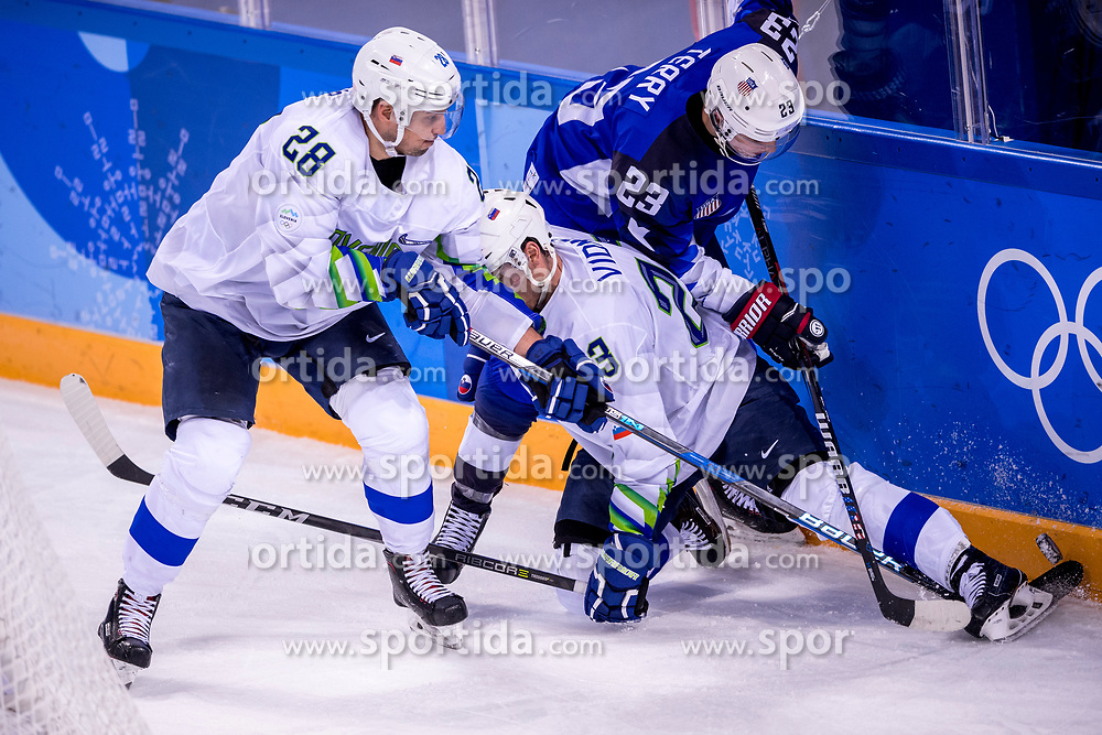 GANGNEUNG, SOUTH KOREA - FEBRUARY 14:  defenseman Ales Kranjc #28 of Slovenia, forward Troy Terry #23 of the United States during Ice Hockey match between Slovenia and USA in the Men's Ice Hockey Preliminary Round Group B at Gangneung Hockey Centre on February 14, 2018 in Gangneung, South Korea. Photo by Ronald Hoogendoorn / Sportida
