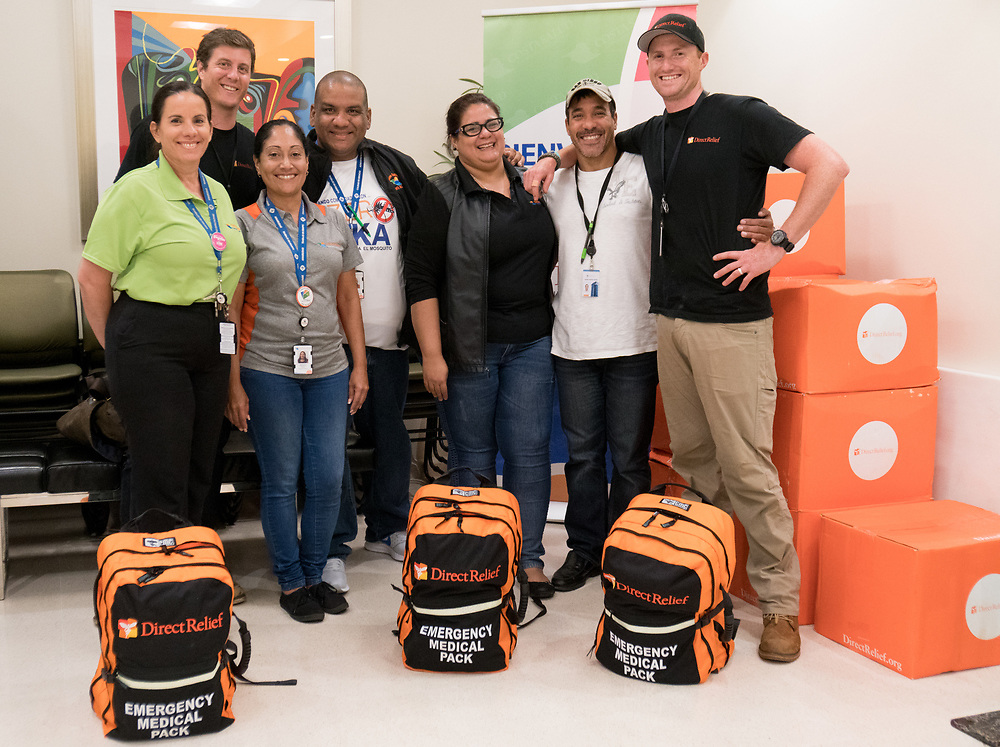 OCTOBER 6, 2017--RINCON, PUERTO RICO ---<br /> Costa Salud Hospital staff shoot a group portrait after medical supplies were delivered by Direct Relief following the path of Hurricane Maria through Puerto Rico.<br /> (Photo by Angel Valentin/Freelance)