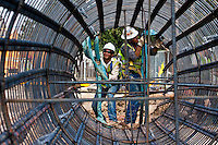 Construction workers work on the continuation of the red line o the north line station, an extension of 5.28 miles, Sept. 23, 2011 in Houston. The completion date for the expansion is 2014. (Eric Kayne/For the Chronicle)