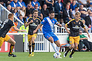 Billy Paynter (Hartlepool United) retains the ball watched by Cambridge United players Mark Roberts (l) Luke Berry (r) and Robbie Simpson (c) during the Sky Bet League 2 match between Hartlepool United and Cambridge United at Victoria Park, Hartlepool, England on 19 September 2015. Photo by George Ledger.