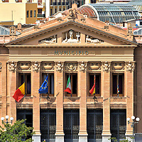 Municipio Town Hall in Messina, Italy<br /> Messina's Town Hall is commonly called Municipio, the name emblazoned on the pediment. Above it is the image of Queen of the Pelorus flanked by two mermaids. The formal name is Palazzo Zanca or the Zanca Palace in honor of the architect, Antonio Zanca. This Neoclassical structure looks older than its completion date of 1924. The original building was replaced after two devastating earthquakes in 1783 and 1908.