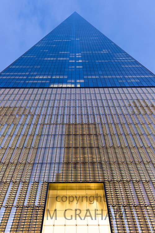 One World Observatory at One World Trade Center creating triangular shape and lights on in Downtown New York, USA