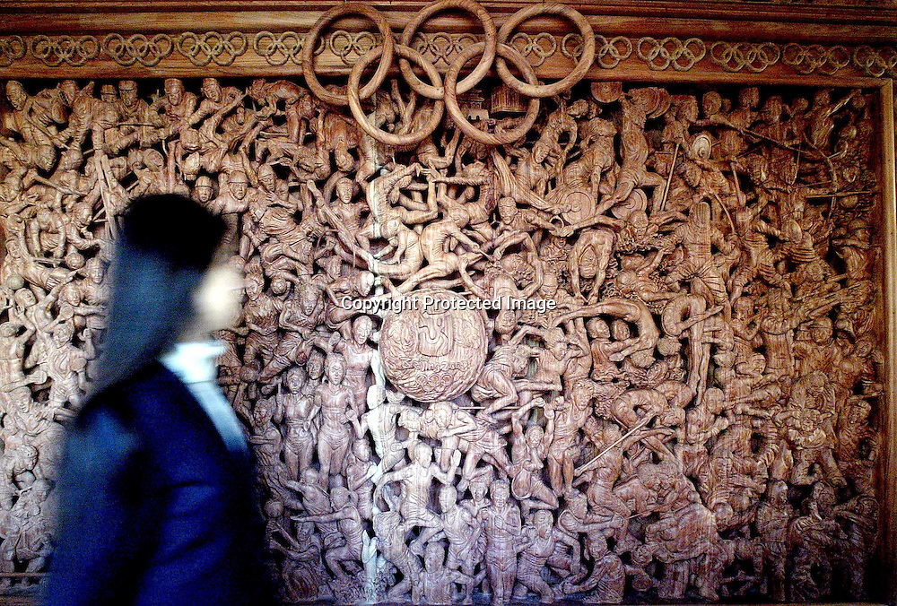 Nov 29, 2007, Beijing, A huge Olympic folding screen which is sculped by Cheng Guomin. It is a woodcarving with 715 chatacters, 20 Olympic mascot and about 40 sports on it.