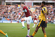 Burnley defender Michael Keane (5)  shot is blocked  during the Premier League match between Burnley and Arsenal at Turf Moor, Burnley, England on 2 October 2016. Photo by Simon Davies.