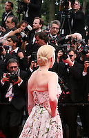 Nadja Auermann with photographers at the the Grace of Monaco gala screening and opening ceremony red carpet at the 67th Cannes Film Festival France. Wednesday 14th May 2014 in Cannes Film Festival, France.