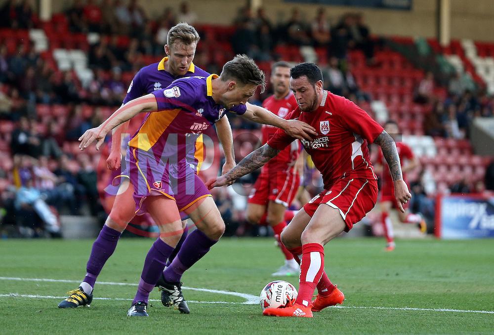 Lee Tomlin of Bristol City takes on Asa Hall of Cheltenham Town - Mandatory by-line: Robbie Stephenson/JMP - 25/07/2016 - FOOTBALL - Abbey Business Stadium - Cheltenham, England - Cheltenham Town v Bristol City - Preseason Friendly