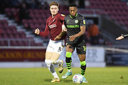 Northampton Town midfielder Ryan Watson (8) battles for possession  with Forest Green Rovers midfielder Ebou Adams (14) during the EFL Sky Bet League 2 match between Northampton Town and Forest Green Rovers at the PTS Academy Stadium, Northampton, England on 14 December 2019.