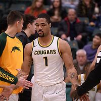 4th year forward Shawn Lathan (1) of the Regina Cougars in action during the home opener on November  10 at Centre for Kinesiology, Health and Sport. Credit: Arthur Ward/Arthur Images