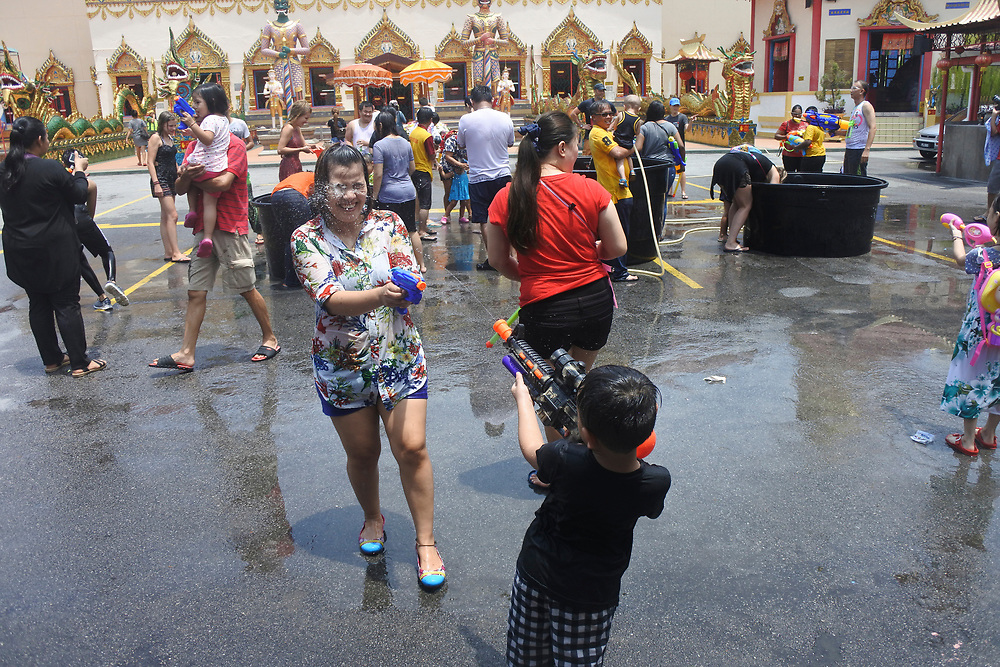 Young kid looking for a target for hist water pistol at the Songkran festival