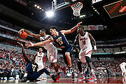 LOUISVILLE, KY - JANUARY 28: Chane Behanan #21 of the Louisville Cardinals reaches for the ball against Talib Zanna #42 and Steven Adams #13 of the Pittsburgh Panthers during the game at KFC Yum! Center on January 28, 2013 in Louisville, Kentucky. Louisville defeated Pitt 64-61. (Photo by Joe Robbins)