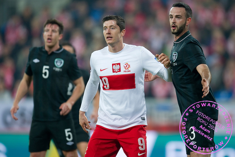 Poland's Robert Lewandowski (L) with Marc Wilson of Ireland (R) watch th ball during international friendly soccer match between Poland and Ireland at Inea Stadium in Poznan on November 19, 2013.<br /> <br /> Poland, Poznan, November 19, 2013<br /> <br /> Picture also available in RAW (NEF) or TIFF format on special request.<br /> <br /> For editorial use only. Any commercial or promotional use requires permission.<br /> <br /> Mandatory credit:<br /> Photo by © Adam Nurkiewicz / Mediasport