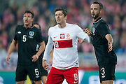 Poland's Robert Lewandowski (L) with Marc Wilson of Ireland (R) watch th ball during international friendly soccer match between Poland and Ireland at Inea Stadium in Poznan on November 19, 2013.<br /> <br /> Poland, Poznan, November 19, 2013<br /> <br /> Picture also available in RAW (NEF) or TIFF format on special request.<br /> <br /> For editorial use only. Any commercial or promotional use requires permission.<br /> <br /> Mandatory credit:<br /> Photo by &copy; Adam Nurkiewicz / Mediasport