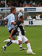 Alex da Silva (Randers FC) presses af Dimitri de Martignac (Elite 3000).