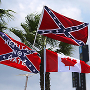 Confederate flags fly in the infield prior to the 57th Annual NASCAR Coke Zero 400 stock car race at Daytona International Speedway on Sunday, July 5, 2015 in Daytona Beach, Florida.  (AP Photo/Alex Menendez)