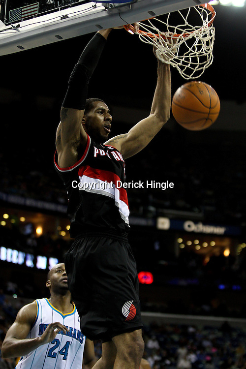 March 30, 2011; New Orleans, LA, USA; Portland Trail Blazers power forward LaMarcus Aldridge (12) dunks against the New Orleans Hornets during the fourth quarter at the New Orleans Arena. The Hornets defeated the Trail Blazers 95-91.   Mandatory Credit: Derick E. Hingle