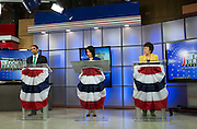 Rajesh Barnabas (Green Party), Cheryl Dinolfo (Republican), and Sandy Frankel (Democrat), left to right, participate at a debate for Monroe County Executive in Rochester on Wednesday, October 21, 2015.