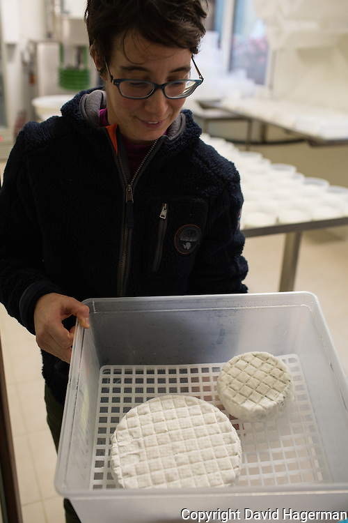 Benedetta Rebora, owner of Cascina Isadora with some of her fresh goat cheeses