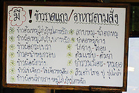 Menu sign written in Thai language.