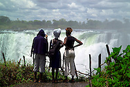LIVINGSTONE, VICTORIA FALLS, ZAMBIA, DECEMBER 2004. Women look at the Victoria Falls from the Zimbabwe side. Victoria falls on the border between Zambia and Zimbabwe is the outdoor adventure capital of Africa. Photo by Frits Meyst/Adventure4ever.com