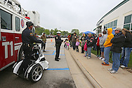 Cedar Rapids Police Officer Mitchell Crist (center) talks about bike safety during the 2nd Annual Bike Rodeo at Kaplan University, 3165 Edgewood Parkway, in Cedar Rapids on Saturday morning, April 28, 2012. Activities included a safety talk from the Cedar Rapids Fire Department and Cedar Rapids Police Department, bike adjustments, a bike helmet giveaway, RAGBRAI themed course, and bike giveaway drawing. (Stephen Mally/Freelance)