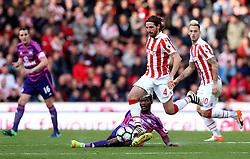 Joe Allen of Stoke City is tackled by Didier Ndong of Sunderland - Mandatory by-line: Robbie Stephenson/JMP - 15/10/2016 - FOOTBALL - Bet365 Stadium - Stoke-on-Trent, England - Stoke City v Sunderland - Premier League