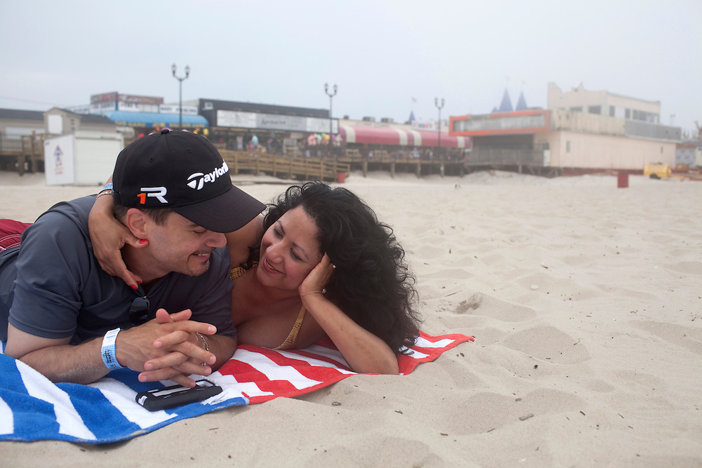 Seaside Heights, NJ - June 30, 2013 :  Steve Pepe and Linda Barbosa from Orange Co, NY, in front of the newly built boardwalk at Seaside Heights, NJ on June 30, 2013. People are returning to the beaches for the summer after recovery efforts post Sandy.
