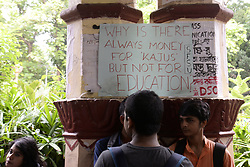 July 5, 2018 - Kolkata, West Bengal, India - Student of Jadavpur University hold poster and shout slogan during the sit in protest against the university decision to scrap the entrance tests for undergraduate course at Jadavpur University. (Credit Image: © Saikat Paul/Pacific Press via ZUMA Wire)