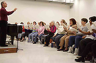 Neal Gittleman leads the women of the Dayton Philharmonic Chorus as they rehearse for their upcoming performance of Mahler's Third Symphony, Tuesday, January 2, 2007. In the front row are (left to right) Carla Ballou, Lillian Chambliss, Anita Campbell, Jill Lewis, Pat Armstrong, Ellen Barnett, Donita Carman, Sharon Williamson, Peg Holland and Valerie Little.