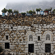 Plants decorate the rooftop of a stone home in the 11th century village of Al Hajjara perched on a hilltop in the Haraz mountains.