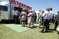 © Licensed to London News Pictures. 5/11/2013. Racegoers lining up for burgers in the general admission area during Melbourne Cup Day at Flemington Racecourse on November 5, 2013 in Melbourne, Australia. Photo credit : Asanka Brendon Ratnayake/LNP