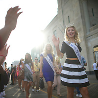 Miss North Carolina and fellow Miss America contestants wave to fans, strolling down the boardwalk following an introduction ceremony on the boardwalk in Atlantic City, NJ on September 3, 2014.  Historically the setting for the pageant, Atlantic City hosted for the first time again last year.  Economically the city is struggling, 4 casinos have already or will be closing in the near future.