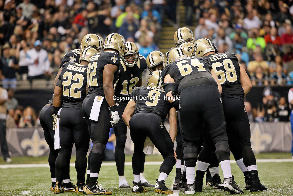 Dec 6, 2015; New Orleans, LA, USA; New Orleans Saints quarterback Drew Brees (9) huddles with teammates during a game against the Carolina Panthers in the first half at Mercedes-Benz Superdome. Mandatory Credit: Derick E. Hingle-USA TODAY Sports