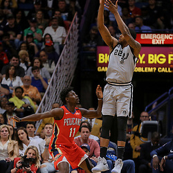 Apr 11, 2018; New Orleans, LA, USA; San Antonio Spurs forward Rudy Gay (22) shoots over New Orleans Pelicans guard Jrue Holiday (11) during the first quarter at the Smoothie King Center. Mandatory Credit: Derick E. Hingle-USA TODAY Sports