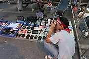 A man looks at binoculars that are on sale in an occupied area during the Red Shirts anti-government protest in the Silom area of Bangkok.