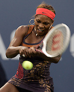 Serena Williams of the returns a forehand to Ana Ivanovic of Serbia and Montenegro in their third round match on the seventh day of the 2006 US Open tennis tournament in Flushing Meadows New York Sunday 03 September 2006 (Andrew Gombert for The New York Times)