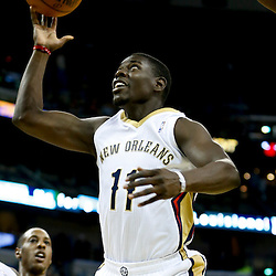 Oct 23, 2013; New Orleans, LA, USA; New Orleans Pelicans point guard Jrue Holiday (11) shoots against the Miami Heat during the first half of a preseason game at New Orleans Arena. Mandatory Credit: Derick E. Hingle-USA TODAY Sports