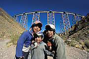 Children before the viaduct above the desert canyon La Polvorilla for the tren de las Nubes, Atacama desert, Argentina