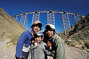 Children before the viaduct above the desert canyon La Polvorilla for the tren de las Nubes, Atacama desert, Argentina