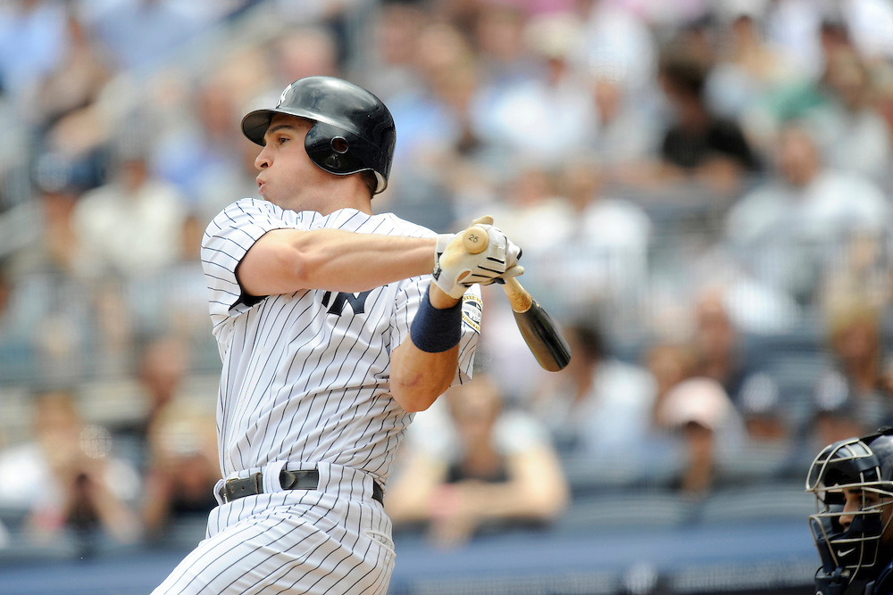 NEW YORK - JUNE 06: Mark Teixeira #25 of the New York Yankees bats against the Tampa Bay Rays on June 6, 2009 at Yankee Stadium in the Bronx borough of New York City. The Rays defeated the Yankees 9 to 7. (Photo by Rob Tringali) *** Local Caption *** Mark Teixeira