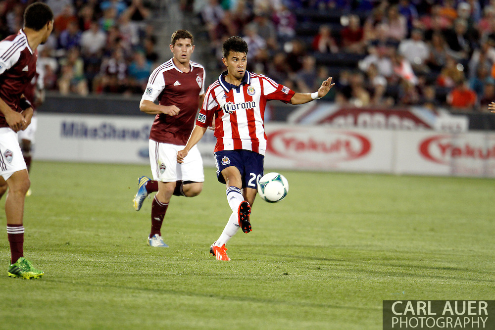 May 25th, 2013 Commerce City, CO - Chivas USA midfielder Carlos Alvarez (20) floats a pass towards the goal in the second half of action in the MLS match between Chivas USA and the Colorado Rapids at Dick's Sporting Goods Park in Commerce City, CO