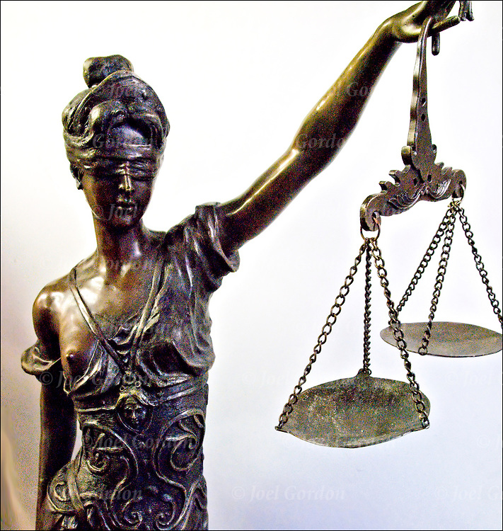 Lady Justice, the Roman Goddess of Justice and sometimes, simply &quot;Justice&quot; is an allegorical personification of the moral force that underlies the legal system. Since the Renaissance, she has frequently been depicted as a bare-breasted woman carrying a sword and scales, and sometimes wearing a blindfold.<br /> <br /> Blind Justice is the theory that law should be viewed objectively. That means that determination of innocence or guilt should be made without bias or prejudice. It is the idea behind the United States Supreme Court motto ?Equal Justice Under Law?. However, it has not always been indicative of fairness.